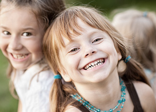 Two little girls smiling together